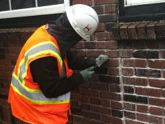 COURTESY PHOTO: COLLEEN CAHILL - Members of the Oregon bricklayers union (BAC Local 1 Oregon/Washington/Idaho/Montana) are donating their time and materials to restore brick work on the historic Cedar School. Theyre  doing the work the old-fashioned way,